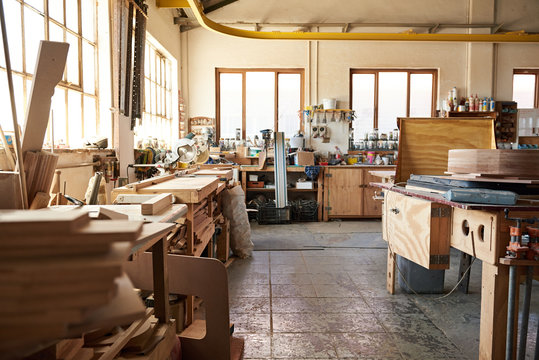 Interior of a large bright woodworking workshop