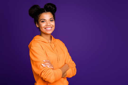 Turned photo of casual cute charming fascinating gorgeous teen with arms crossed looking at you smiling toothily near empty space isolated vibrant color purple background