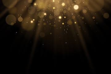 Wall Mural - Golden flash of light with glares bokeh on a black background. Rays of light with glitter. Vector illustration