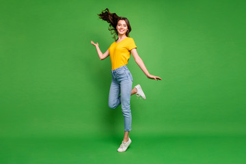 Full length body size view of her she nice attractive lovely cheerful cheery wavy-haired girl standing on tiptoe having fun free time isolated over bright vivid shine vibrant green color background Wall mural