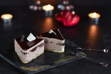chocolate cakes on a dark background with candles