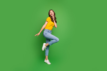 Full length body size view of her she nice attractive lovely slim fit thin curious dreamy cheerful cheery wavy-haired girl having fun isolated on bright vivid shine vibrant green color background