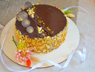 Chocolate glazed peanut cake on a backing