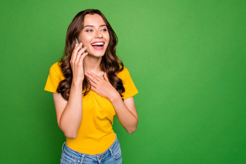Fototapete - Portrait of her she nice attractive lovely charming pretty glad friendly cheerful cheery wavy-haired girl calling home discussing news isolated on bright vivid shine vibrant green color background