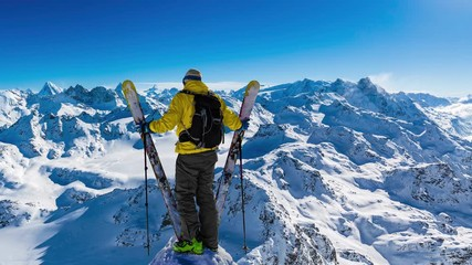 Wall Mural - Aerial view of skiing with amazing view of swiss famous mountains in beautiful winter snow  Mt Fort.