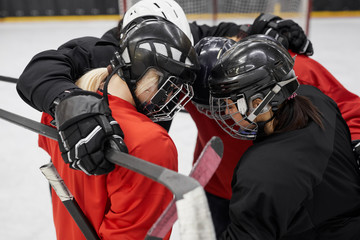 Poster Xian High angle portrait of female hockey team huddling for motivation before sports match