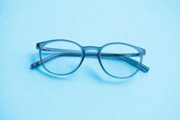 eyeglasses isolated on blue background