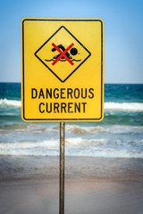 Warning sign for swimmers to beware dangerous currents