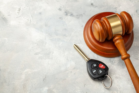 Car accident. Judge gavel and car bleeding with alarm. Car Insurance Solution