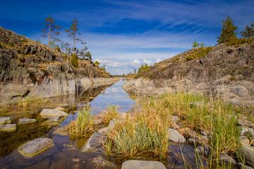 Wall Mural - Karelia. Russia. The nature of Karelia. Ladoga. Traveling around Karelia. A small river between the rocks. Hiking tours to Lake Ladoga. Escorted Russian Tours. Western European Russia travel.