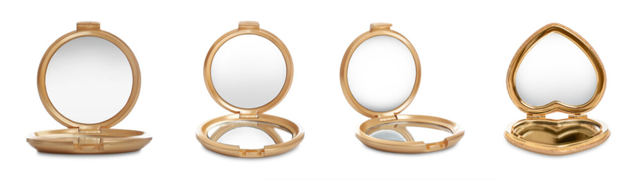 Set of different compact mirrors on white background