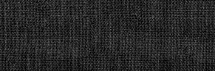 Photo sur Aluminium Tissu Panoramic close-up texture of natural weave cloth in dark and black color. Fabric texture of natural cotton or linen textile material. Black fabric wide background.