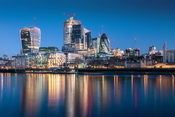 Poster London London skyscraper skyline with reflection in Thames river during twilight in London, UK