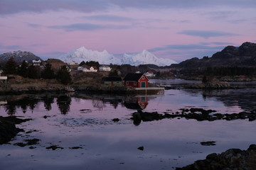 Wall Murals Northern Europe Beautiful typical fishermans town located in Lofoten Islands, Norway. Rorbu houses in the bay of Ballstad. Pink sunrise in the background.