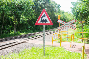 Puerto Iguazu, Argentina - Circa November 2019: Train warning sign, railway crossing at the Iguazu National Park