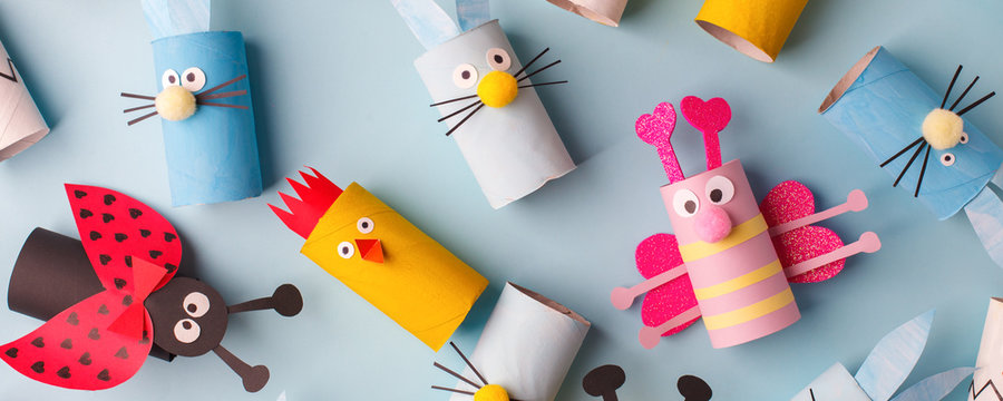 Happy easter kindergarten decoration concept - rabbit, chicken, egg, bee from toilet paper roll tube. Simple diy creative idea. Eco-friendly reuse recycle banner, daycare paper craft