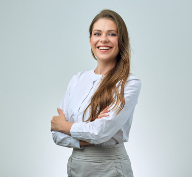 Smiling woman with toothy smile wearing white shirt.