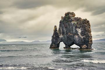 Rhino-like exotic rock formation during dusk --  Hvitserker, Iceland