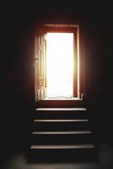Light entering through open door in church