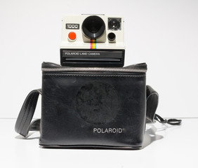 london, england, 05/09/2019 A retro polaroid 1000 polaroid land camera instant photo film producer. retro hipster fashionable vintage festival cameras. instagram photography feel colour grade.