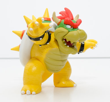 london, england, 05/05/2018 a super mario official nintendo 1990s bowser toy isolated on a white background. official merchandise. bowser mariokart action figure.