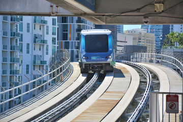 MIAMI, USA - MARCH 19, 2017 : Metromover train drives to the station in Downtown Miami. Metromover is a free automatic transport system in Miami.