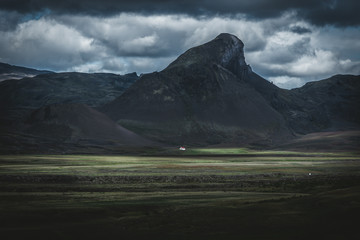 Printed roller blinds Gray traffic Dominant mountain with the tiny white house in the foreground illuminated by light
