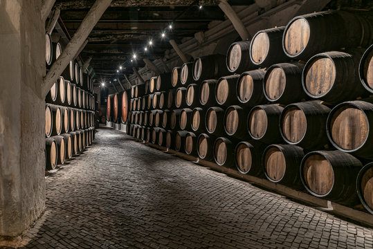 Portugal, Spain - Sept 20, 2019: Wine cellar used to age Port wine in Port, Portugal Old cellar used to keep the special wine distilled in Portugal