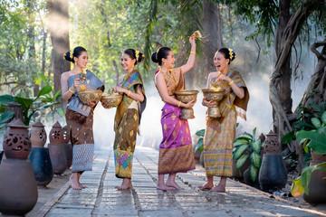 Beautiful Asian woman splashing water during tradition festival Thai,Songkran festival.