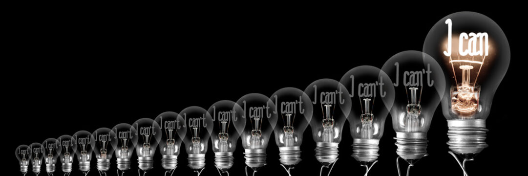 Light Bulbs with I Can't I Can Concept