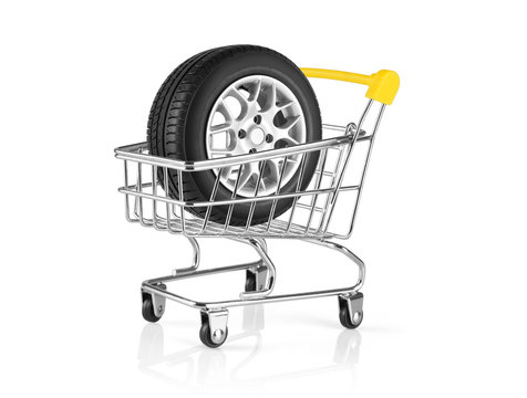Car wheel in mini toy trolley for shopping isolated