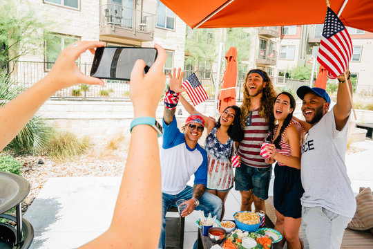 Air Force Veteran and friends having a 4th of July BBQ party at apartment complex.