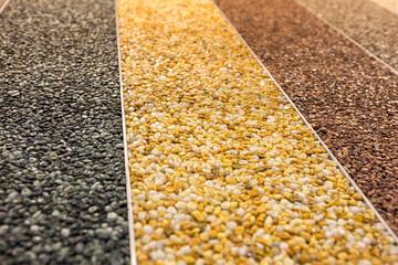 Close up of a natural stone carpet. Decorative stone coating. Slip resistant floor finish...
