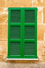 Shutters and window on the wall
