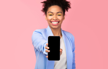 Wall Mural - Black girl showing blank cell phone screen at studio