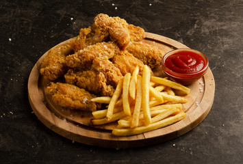 Fried chicken wings, french fries and ketchup sauce Fotobehang