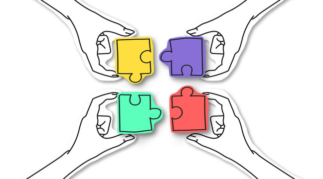 Four hands connecting colorful puzzles over white