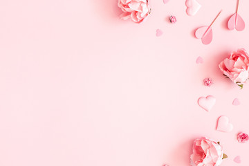 Foto op Canvas Bloemen Valentine's Day background. Pink flowers, envelope, hearts on pastel pink background. Valentines day concept. Flat lay, top view, copy space