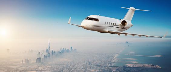 Private jet plane flying above Dubai city Fotomurales