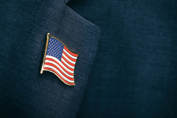 Element of male suit with USA flag pin on chest