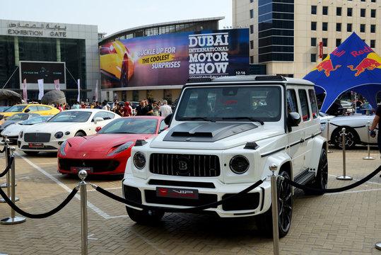 DUBAI, UAE - NOVEMBER 16: The Brabus G-Wagen,  Ferrari 812 Superfast and Bentley Continental GT sportscars are on Dubai Motor Show 2019 on November 16, 2019