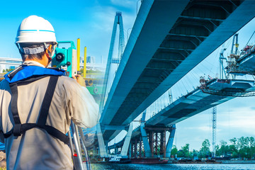 The use of the theodolite to control of sophisticated construction works. A man with a theodolite checks the angles of inclination when repairing the bridge. Execution of projects of any complexity.