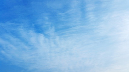 A Blue Sky Abstract. A blue sky with just a wisp of cloud to use being a backing or backdrop royalty free stock photo.