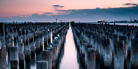 Iconic post stumps stand pround at the end of princess pier in meblurne australia