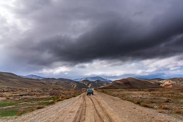 SUV Hyundai Tucson on a dirt mountain road