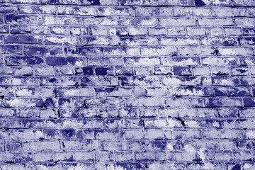 Old brick wall texture close up. Abstract background blue color toned