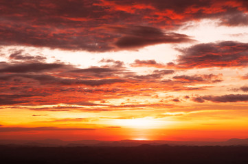 Beautiful red vibrant burning sunset sky with clouds