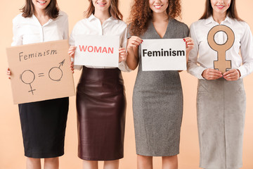 Young women on color background. Concept of feminism