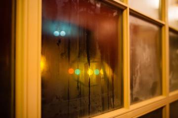 Keuken foto achterwand Smal steegje Colorful reflections on a wet window