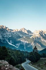 Vertical high angle shot of Valbona Valley National Park under a clear blue sky in Albania
